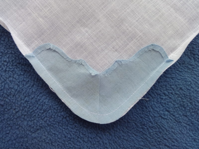 Corner stitched, rounded, trimmed