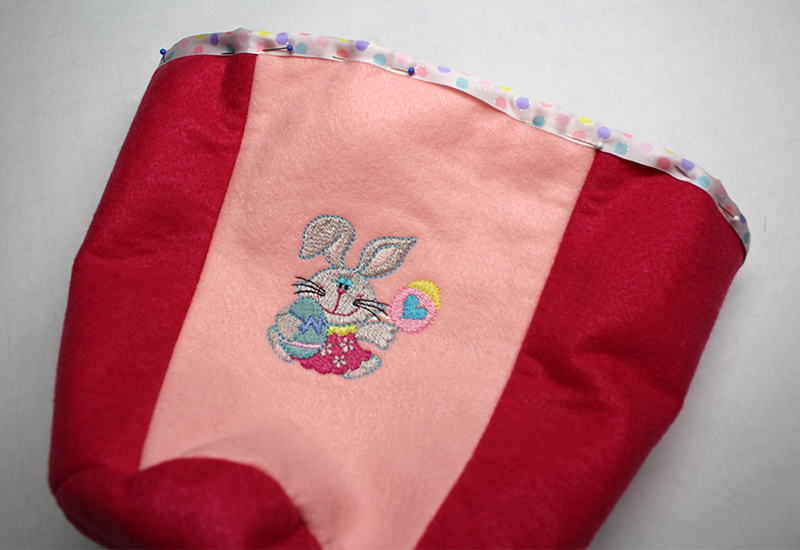 Easter Basket 37-Pin to the top edge of the basket. Stitch along the edge of the ribbon.